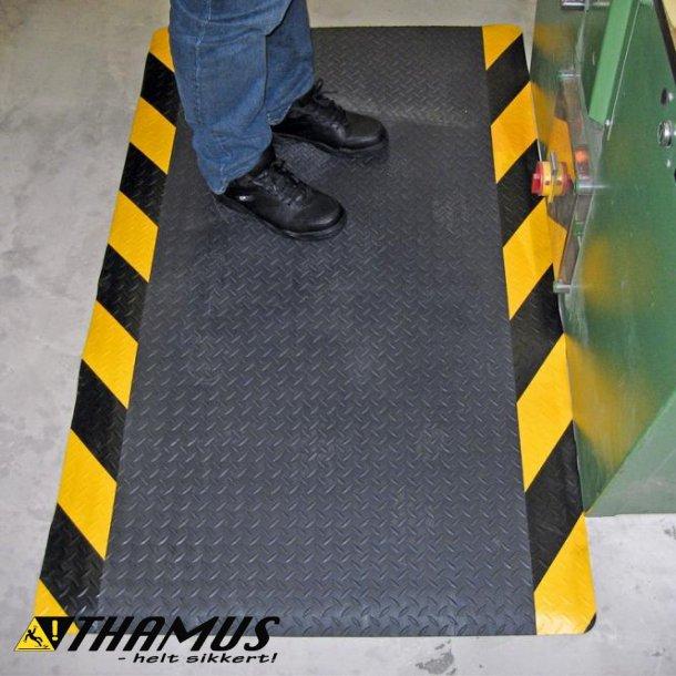 Ergonomisk måtte med dørkplade mønster, med sort/gul kant